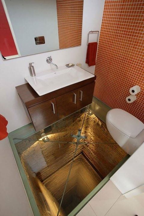 Bathroom with a glass floor over abandoned elevator shaft.   Source: Reddit